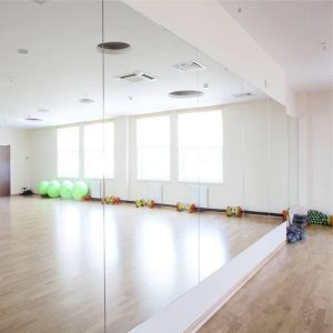 custom cut yoga studio wall mirrior by Hopkins Glass