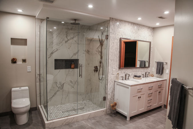 Beau Bathroom With Glass Shower And White Vanity