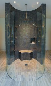 walk in shower with curvy glass walls