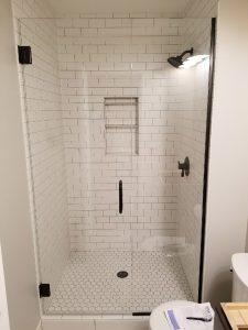 inline door and panel frameless glass shower