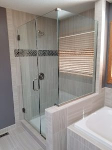 frameless glass shower enclosure with inline panel and 90 degree return