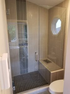 inline door and panel custom frameless glass shower enclosure