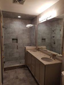 inline door and panel frameless glass shower and custom cut bathroom vanity mirror