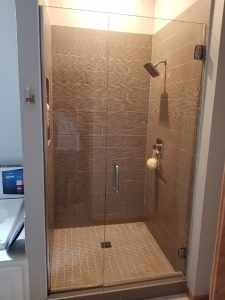 inline door and panel custom frameless glass shower doors
