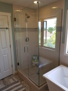 frameless glass shower door with inline panel and 90 degree return