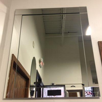 Mirror with prairie style border overlay